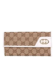 992724dc171 Beige GG fabric with white leathertrim interior Tab snap closure Seven card  slots and two bill compartments Separate coin pocket