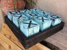 Made from weathered inch wood blocks, set in a sh… Rustic Tic Tac Toe game. Made from weathered inch wood blocks, set in a shallow, sectioned, black colored tray. Overall game is x x tall 4x4 Wood Crafts, Wood Block Crafts, Wood Blocks, Fun Crafts, Outdoor Wood Projects, Diy Wood Projects, Diy Projects To Try, Projects For Kids, Diy Yard Games