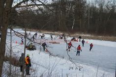 There are no high sticks or body-checking in Pond Hockey. It is strictly a recreational game. There is also no goal tender. As you can see from this photo, the goal is low and small. The puck must slide along the ice to enter it.     Soothing photo