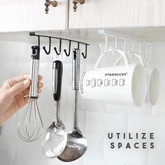 Fear that the kitchen is messy? The Under-Cabinet Hanger Rack offers a convenient way to hang cups, cookware, towels, gloves or anything you want to hang under Under Shelf Storage, Storage Rack, Storage Shelves, Basket Storage, Rack Shelf, Kitchen Organization, Kitchen Storage, Organized Kitchen, Kitchen Rack