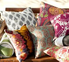 I like the idea of color through pillows and other decor. Love these expensive PB pillows