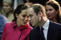 """Catherine, the Duchess of Cambridge talks to her husband Prince William, Duke of Cambridge while they visit the organization """"The Door"""" and the City Kids Foundation December 9, 2014"""