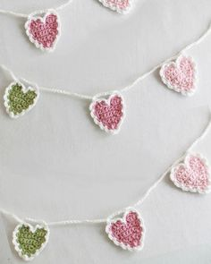 Crochet a string of hearts. Pretty in sparkly thread or yarn on a Christmas tree. Or just casually draped around a window. Pattern provided.
