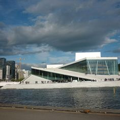 The Oslo Opera house can be viewed from afar along a promenade made for that. So you can take a picture from a distance, then you can go the opera. Its construction is such that one can walk to the roof of the Opera House with ease. http://www.mariacomestotown.com/oslo-on-a-shoe-string/