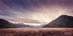 The sun setting behind the mountains at Arthurs Pass