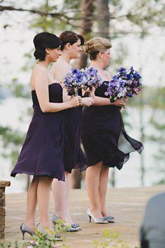 Dark purple bridesmaids' dresses by Bill Levkoff