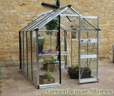 Greenhouses for sale from the top brands with free UK delivery. Buy aluminium and timber greenhouses online now! 6x8 Greenhouse, Modern Greenhouses, Greenhouses For Sale, Sliding Door Systems, Sliding Doors, Tall Plants, Shed Plans, Wells, Gardens
