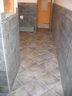 Image from http://www.for-vista.com/wp-content/uploads/2015/10/flooring-floor-tiles-bathroom-wooden-floor-wall-tiles-on-floor.jpg.