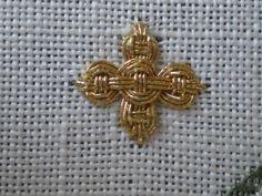 http://www.threadsacrosstheweb.blogspot.co.uk/2012/09/guilloche-stitch-variation-cross.html