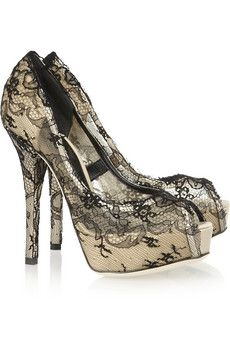 Dolce & Gabbanalace-covered satin pumps.