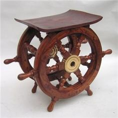 Steer this hand-crafted wooden nautical wheel table right into your living room!