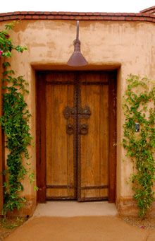 This is a fantastic entrance for the Southwest adobe style and you just know there is a great courtyard hidding behind this door.