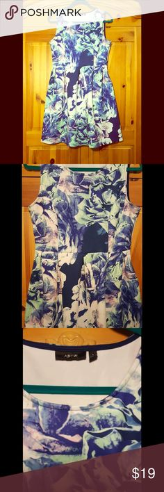 Floral APT.9 Dress Size Lg Beautiful blue floral dress from APT.9 In FLAWLESS condtion. Has a comfortable fit and flare fit. Fits size L. Has great stretch and could also fit an XL. The length of this dress is 36 inches. Please let me know if you have any questions!! and feel free to make me a reasonable offer!! I offer SAME DAY SHIPPING on purchases made before 2PM PST. XOXO Apt. 9 Dresses