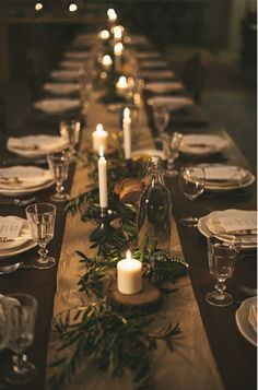 Dark table with table runner and candles.
