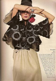Tilly Tizzani in evening dress of parchment-colored silk overlaid with black lace embroidered with black flowers, by Pauline Trigère, Vogue, February 1964.