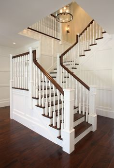 This is a great fix for out dated oak treads and spindles. Paint them White and stain treads and floor antique brown r Jacobean.