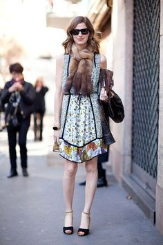 Amanda Brooks shows her boho side in a floral dress paired with a fur scarf.