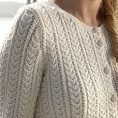 This is a favourite of mine. I love the mini back to back cables that remind me of rope and the slight peplum that's created by the change of stitch. Elegant and timeless, this is a perfect piece to dress up a pair of jeans or complement your best dress.