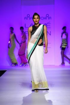 Indian Desinger Arpan Vohra at Lakme Indian Fashion Week as part of Summer 2013. Follow Strand of Silk to get the best of Beautiful Indian Fashion from leading Fashion Designers, including Contemporary Indian Fashion and Indian Bridal clothes like Saris, Anarkalis, Salwar Suits, Lenghas, Indian Jewellery.