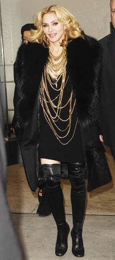 Madonna 's style, black fur coat, lots of necklaces, boots