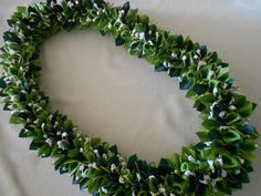 *********************RESERVED*********************  The lei is approximately 36 inches long material/acetate ribbon,satin ribbon,organza ribbon with kukui nuts