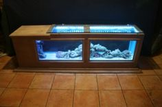 custom 58 gal salt water coffee table     who said fish tank cant be furniture and yes i have other designs