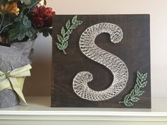 A personal favorite from my Etsy shop https://www.etsy.com/listing/249405423/monogram-string-art