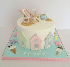Seaside themed birthday cake with deckchair and seaside theme via https://www.flickr.com/photos/swirlsbakery/12914359995/in/photostream/