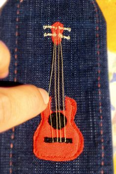 Fabric bookmark - guitar ukelele ukulele - hand made and embroidered - free hand machine embroidery