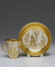 Chocolate Cup and Saucer Irminger, J.J. (model); Seuter, Abraham (painting). Germany, Meissen. Circa 1715-1730 Porcelain; painted in gold. H. 7.7, diam. 7 cm (cup); diam. 14.7 cm (saucer) The State Hermitage Museum