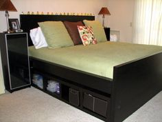 IKEA HACKERS: Malm bed raised to get more under-bed storage space.