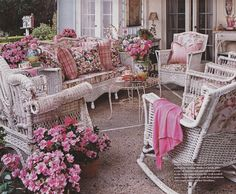 I would love to grow old sitting on my front porch on these wicker and pink rocking chairs- timeless