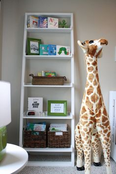 Neutral nursery with pops of green and blue. Love the bookcase.