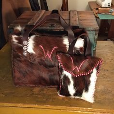 The Buckaroo Diaper Tote with matching Diaper Wallet. The family's initial is on the flap. From gowestdesigns.us