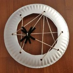Paper plate spider web. For building manual dexterity.