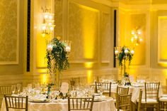 Gold Chiavari Chairs and Floral Centerpieces by The Flower Studio - Wanderlust Wedding at the Waldorf Astoria Orlando - Designed by J.Closs Events - Orange Blossom Bride - Photographer: Layla Eloa Photography - Click Pin for More - www.orangeblossombride.com