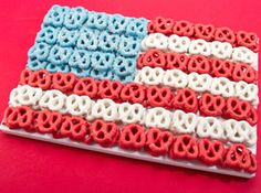 JULY 4th FROSTING-- Dip pretzels in candy melts, frost cake with white, or colored frosting, then place dipped pretzels on cake.  OR,...JUST STACK THEM ON A TRAY!!!  Here's a great idea anyone can do! Chocolate covered pretzels, then arrange in a flag shape!