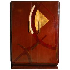"""Art Deco Armoire by Jean Dunand  France  1930's. Commissioned for the luxury steamship """"NORMANDIE"""". From the interior of one of the luxury cabins."""