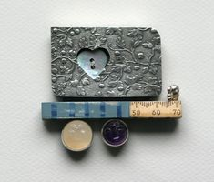 JACK CUNNINGHAM -UK  Me and You Brooch  2003 - white metal, moonstone, amethyst, mother of pearl.  W:7cm H:6.5cm  1100£ at the Scottish Gallery