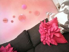 Flowery pillows and bubbly mirrors make for a sophisticated and girly office.