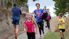 High-fives all round: a family affair at Mt Gambier's Parkrun held every Saturday. (image: ABC/Kate Hill)