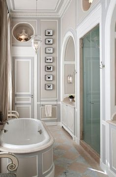 fun bathroom detail using the height in a narrow space    Jean-Louis Deniot. Rue des Saints-Pères apartment.