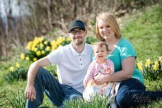 A family sitting on a hillside. Copyright Photographics Solution 2014