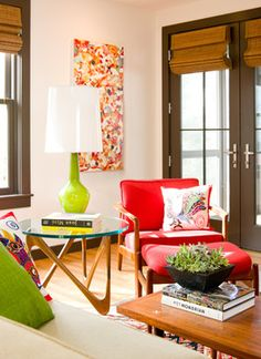 """""""A Moebius side table sets the mid-century tone here. But the contemporary art, bright upholstery and accessories make the room bright and unique."""" (Kristen Rivoli Interior Design)"""
