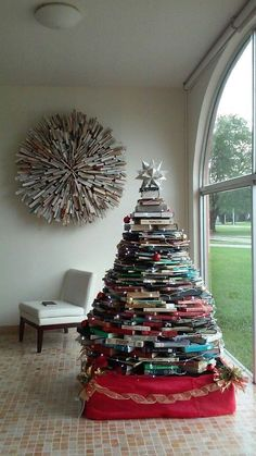 Looking for DIY Christmas decor? This full-sized book tree is a fun Christmas decoration craft idea for the whole family.