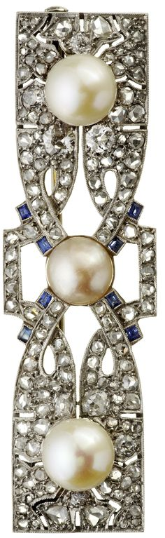 An Art Deco platinum, diamond, sapphire and cultured pearl brooch, French, circa 1930. Length 6cm. #ArtDeco #brooch