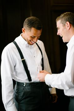 Groom's attire with suspenders for a glamorous Gatsby inspired wedding.