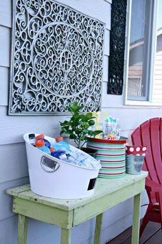 Painted doormats as outdoor wall decor!  *Love, but I'd paint it a bright accent color!
