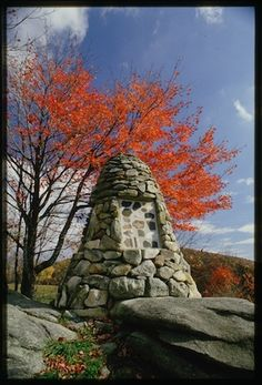 The memorial cairn on Grandfather Mountain has inset panels with seventy-four polished stones contributed by as many clan societies, most brought from the clans' homelands in Scotland.