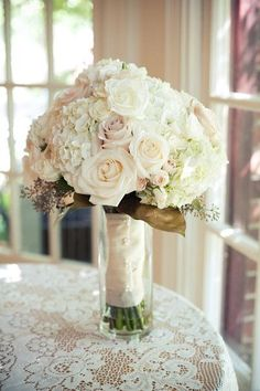Classic cream and pastel rose + hydrangea wedding bouquet wrapped in ivory satin ribbon {Meredith Rogers Photography}